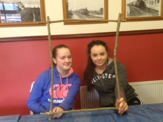 Emma and Tasha with the ash frame for the project's tapestry
